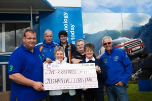 Ford Fair committee members presenting a cheque for £500 to Cancer Research UK at the 2015 show